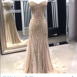 Gold beaded gown purchased at Gautier.